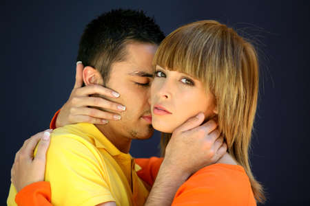 Man kissing girlfriend in the neck photo