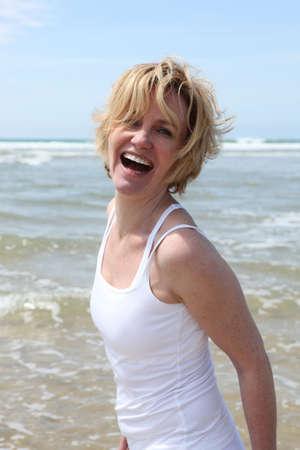 long weekend: Blond woman having fun at the beach