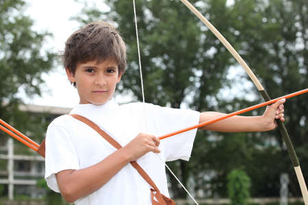 Boy with a bow and arrow photo