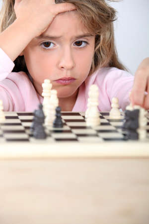 little girl playing chess photo