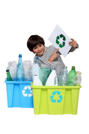 Little boy recycling photo