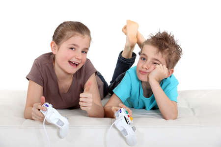 Children playing computer games Stock Photo - 12302734