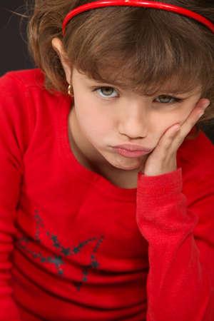 A little girl pouting. photo