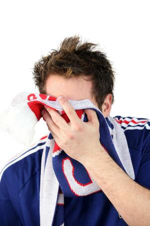 downcast: Downcast French football fan Stock Photo