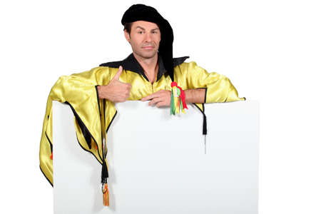 black satin: student wearing ceremonial dress Stock Photo