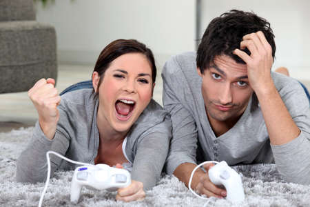 a couple playing video games Stock Photo - 12302250