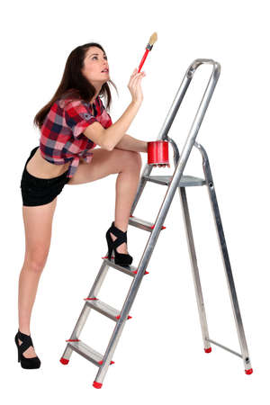 sexy female painter holding brush photo