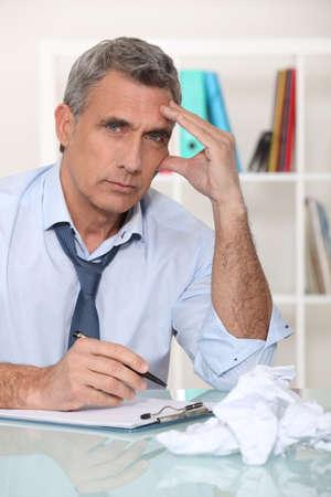 struggling: Frustrated businessman Stock Photo