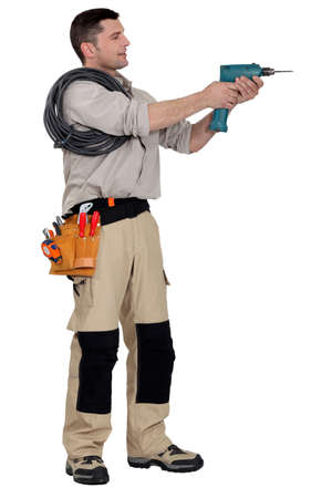 boiler suit: Electrician with a drill