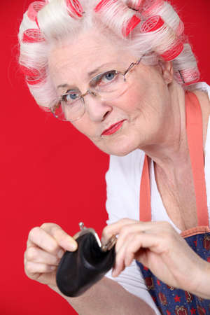 An old lady with an empty wallet. Stock Photo - 12302379