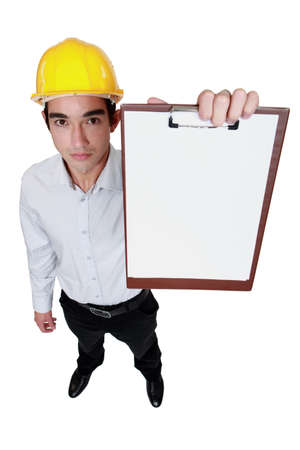 straight faced: Engineer holding up a blank clipboard