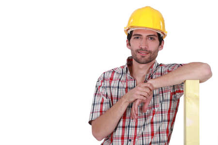 woodworker: Confident carpenter on white background Stock Photo