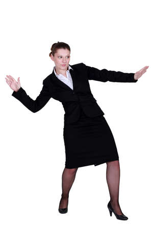straight faced: Businesswoman pretending to surf Stock Photo
