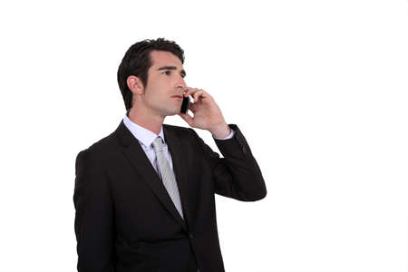 Businessman talking on his mobile phone Stock Photo - 12302232