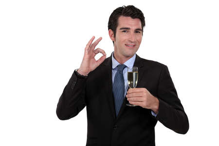 Businessman with champagne Stock Photo - 12302884