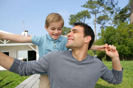 Father and son playing in the garden photo