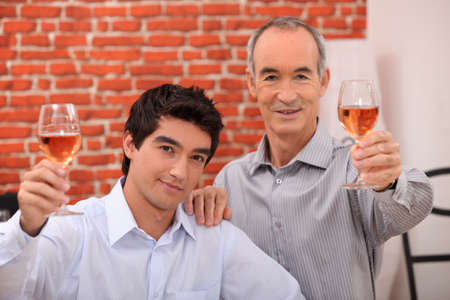 Two men drinking rose photo