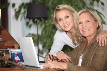 Mother and daughter together at home photo
