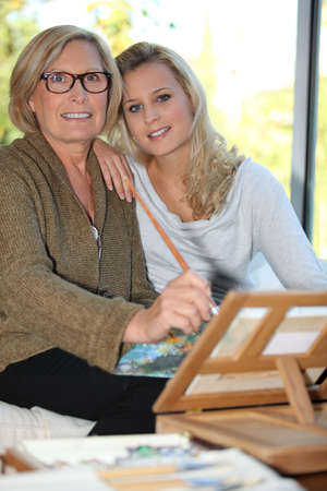 grandmother and granddaughter together at home Stock Photo - 12302427