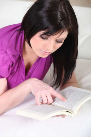 Woman reading novel Stock Photo - 12302314