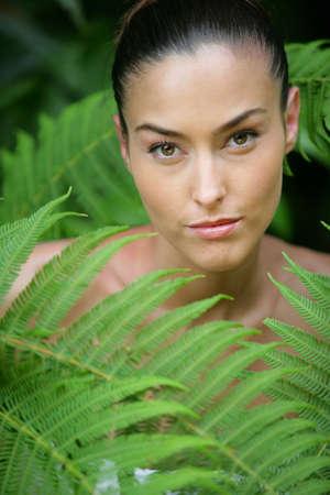 Woman amongst ferns