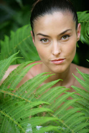 amongst: Woman amongst ferns