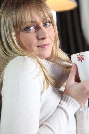 Woman enjoying a hot drink Stock Photo - 12302754