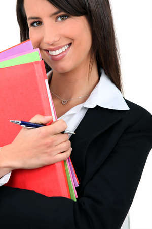 professional woman with folders Stock Photo - 12302658