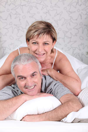 Mature couple in bed photo
