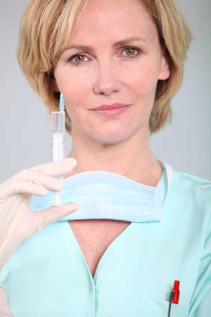 nurse holding syringe photo