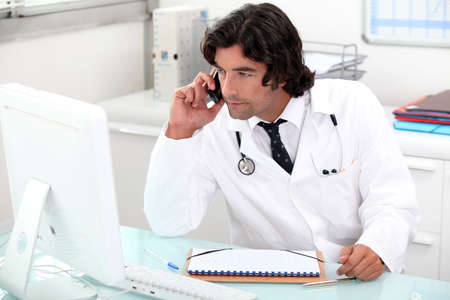 half length posed: Doctor at his desk