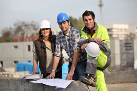 Three construction workers at site Stock Photo - 12302801
