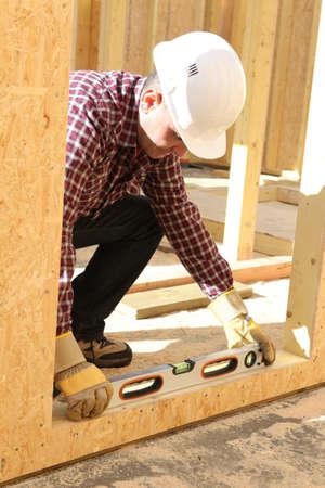 woodworking: Construction worker using a spirit level