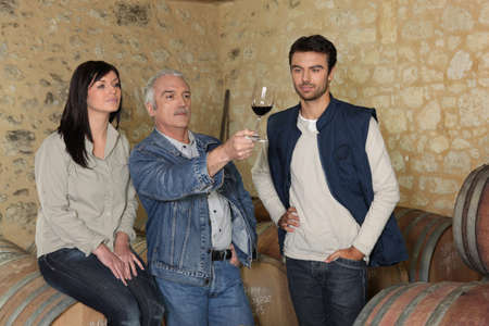 olfaction: Winemakers examining a glass of wine