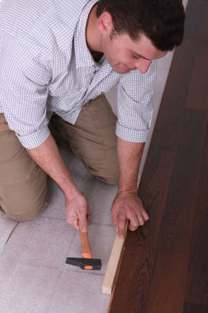 Man putting in new flooring photo