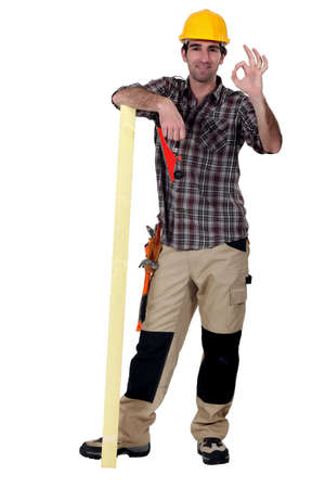 banter: Artisan satisfied with plank of wood Stock Photo