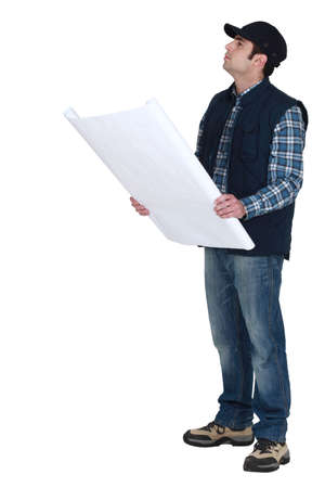 inspect: Man checking the plans. Stock Photo