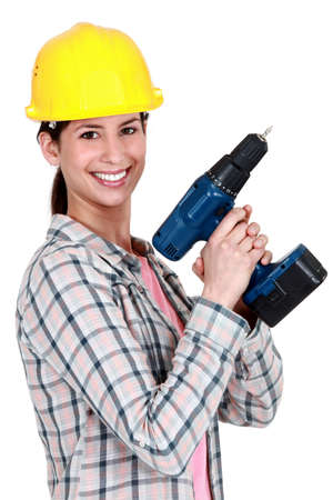 Female construction worker holding a drill Stock Photo - 12367454