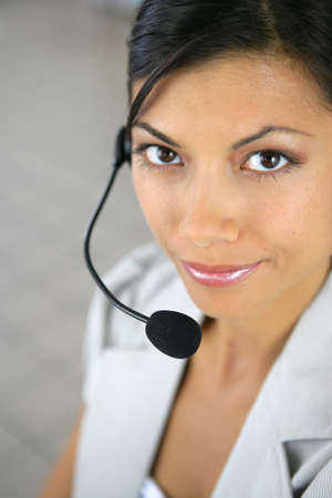 Woman wearing a telephone headset photo
