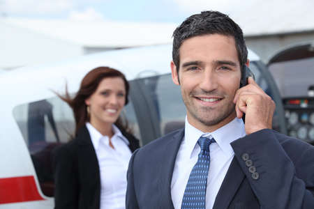Successful businessman in airport photo