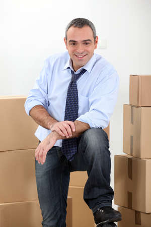 distributor: Ware house manager surrounded by boxes Stock Photo