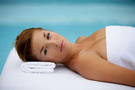 Gorgeous woman lying on table massage photo
