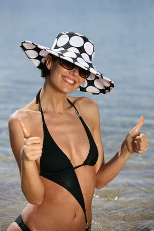 Trendy woman at the beach photo