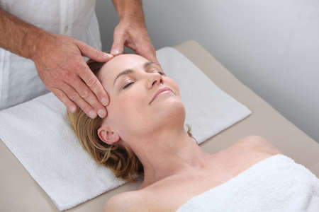 Blond woman receiving massage photo