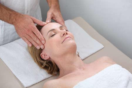 massage table: Blond woman receiving massage
