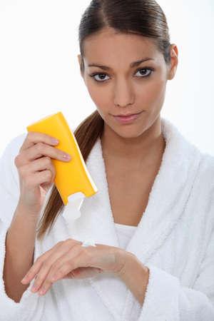 Woman putting on cream Stock Photo - 12365218
