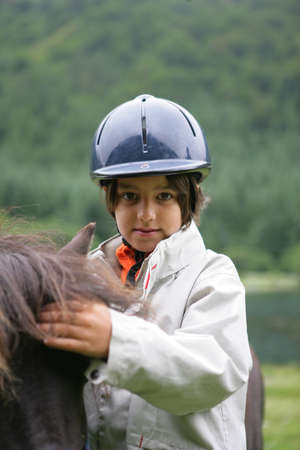 Child with a pony photo