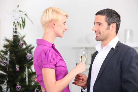 Couple with champagne flutes Stock Photo - 12366040