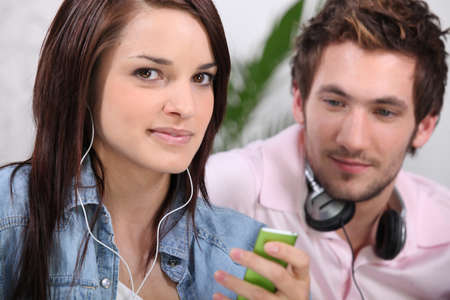 media player: Woman listening to a music