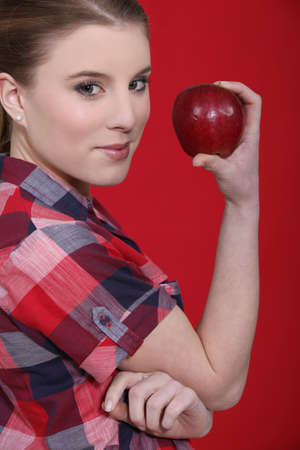 Woman with a red apple photo